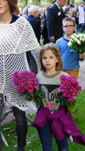 Child with flowers. The Perfect Storm assault on our children.